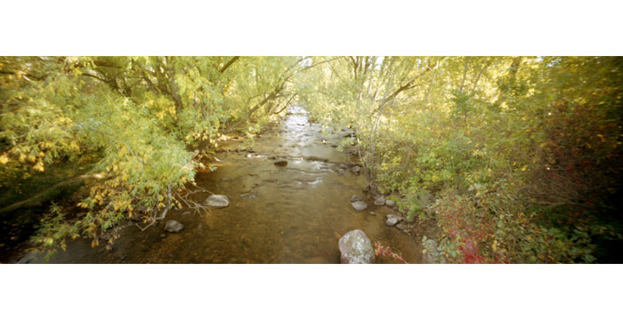 Drainage Ditch, 2008. Pinhole Camera, Color Film, Pigment Inkjet Print, 12x36